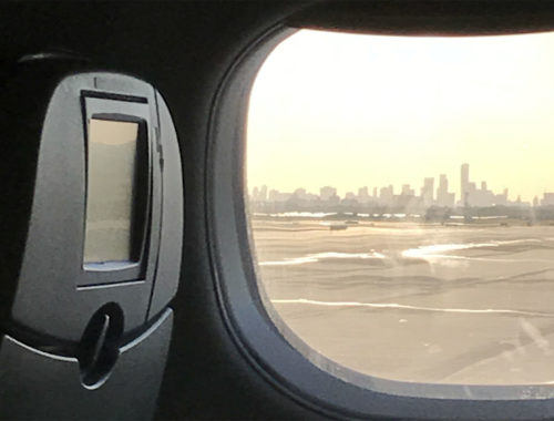 picture of the NYC skyline from an airplane window
